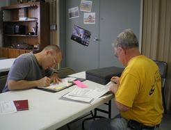 The inspector and I go through the paperwork