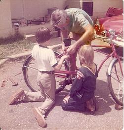 Bike restoration 19 seventy-somethin'. Me in scout uniform. Dad's project in background ('55 T-bird).